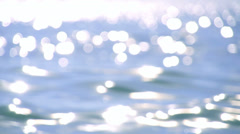Sparkling fresh wavy water is shining on a sunny summer day in slow motion - stock footage