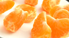 4K Tangerine Orange Slices Rotating Closeup Stock Footage