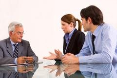 Stock Photo of two men and one woman during a job interview