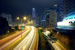 Traffic night and big advertising block Stock Photos