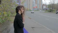 Sad girl reading book on street, feeling nostalgic, melancholia, click for HD Stock Footage