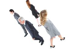 businessmen and businesswomen walking in different directions - stock photo