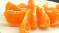 4K Tangerine Slices Rotating On Plate.mp4 Stock Footage