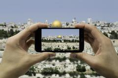 Tourist holds up camera phone at the jerusalem Stock Photos