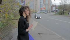 Sad girl reading book on street, feeling nostalgic, melancholia, click for HD - stock footage
