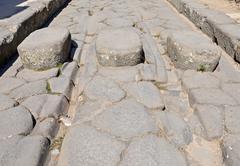 Original ruts in the stone road in ancient pompeii Stock Photos