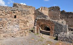 Ruins of ancient roman city of pompeii. shop and sweet pastry bakery. Stock Photos