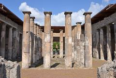 ruins of ancient roman city of pompeii. atrium with 16 doric columns around i - stock photo
