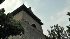 Filming around Bell Tower from a moving tricycle in Beijing, China Stock Footage