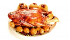 Roast Duck with Potatoes, Apples and Cranberries Dolly Shot Stock Footage