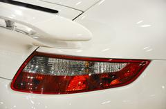 Detail of a white sports car - stock photo
