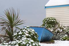 Blue fisherman boat in winter Stock Photos