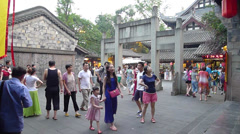 CHENGDU, CHINA: Unidentified tourists visit the famous Jinli ancient street Stock Footage