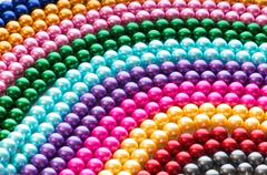 Abstract with colourful pearl necklaces - stock photo