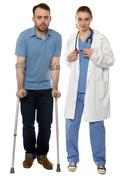 smiling disabled man and female doctor standing - stock photo