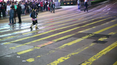 Woman & Child cross street followed by large crowds Slo Mo Stock Footage