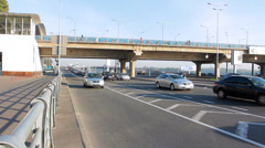 Car Traffic Under Subway Bridge With Station Stock Footage
