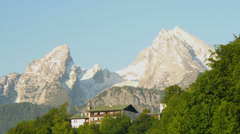 Mountain Watzmann in the alps with country house on the hill. Stock Footage