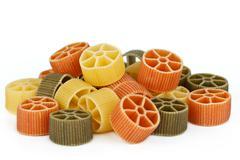 Tricolor pasta on white - stock photo