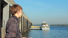 Young Man Watching On River - stock footage