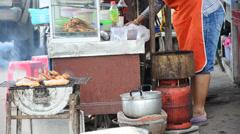 Cooking  roasting chicken thai style on street Stock Footage