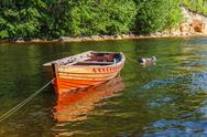 Stock Photo of old wooden boat on the river