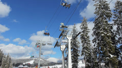 Ski Lifts Moving Over Trees Stock Footage