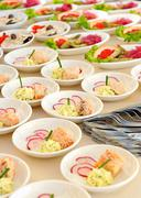 assorted individual salads on a buffet - stock photo