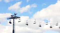 Skiers On Hoist And Sky Stock Footage