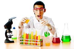 Chemist in the lab experimenting with solutions - stock photo