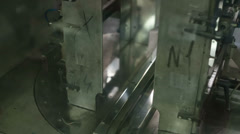 Robot packs in a large stack of newspapers Stock Footage