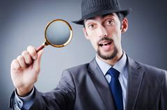 Detective and magnifying glass Stock Photos