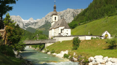 Picturesque view on church and river of Ramsau bavaria with alps. Stock Footage