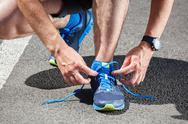 Stock Photo of runner trying running shoes getting ready for run.