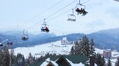 Ski Lifts Above Roofs Stock Footage