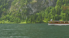 Excursion boat with tourists on the lake Koenigssee in Berchtesgaden. Stock Footage
