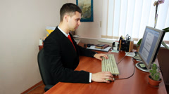 Man Typing Documents At Work - stock footage