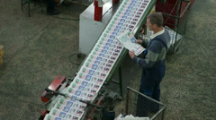 Ready newspaper on production line Stock Footage