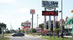 Burger King & gift shop store signs. Orlando strip mall - stock footage
