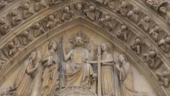Paris, France - famous Notre Dame cathedral facade saint statues. UNESCO Stock Footage