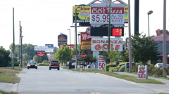 Bonanza Golf & other signs on Orlando strip mall Stock Footage
