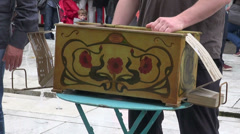 Musicians playing with vintage barrel organ and singing ,Paris Stock Footage