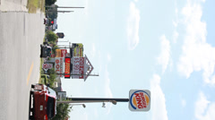 Burger King, Pizza, Golf signs on strip mall. Vertical (9:16) shot Stock Footage