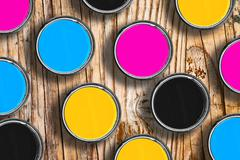CMYK colors in tin cans - stock photo