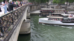 Sunday people, bridge and passenger touristic ship in Seine river,Paris Stock Footage