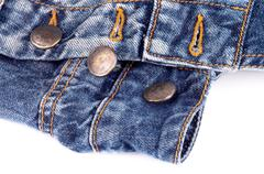 Buttons on Blue Jeans Stock Photos
