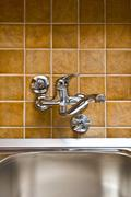 Stainless steel kitchen faucet and sink Stock Photos