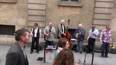 Street musicians seniors  play  in Paris. MAY 25, 2014 in Paris, France Stock Footage