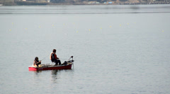 Mt. Fuji and fishermen reflected in Lake Kawaguchi, Japan Stock Footage