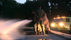 Fuel Fire Suppression airport fire fighters Stock Footage